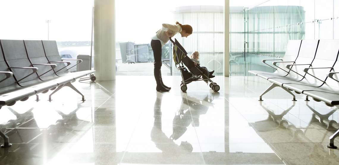 Mother with baby in stroller at the airport