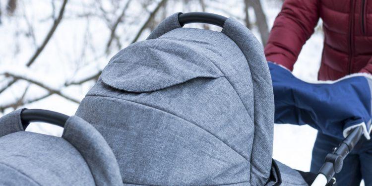 Tandem stroller on winter background
