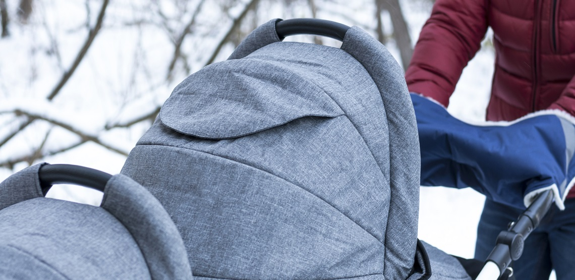 Tandem stroller on winter background