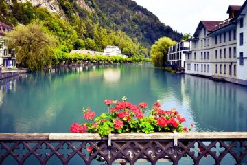 River in Interlaken lined by buildings