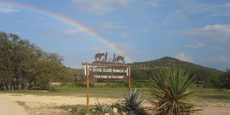 entrance sign for Dixie Dude Ranch
