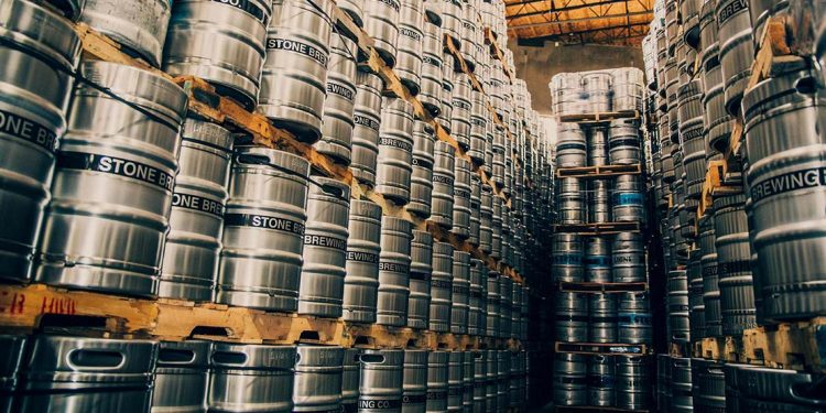 Stacks of silver barrels of beer