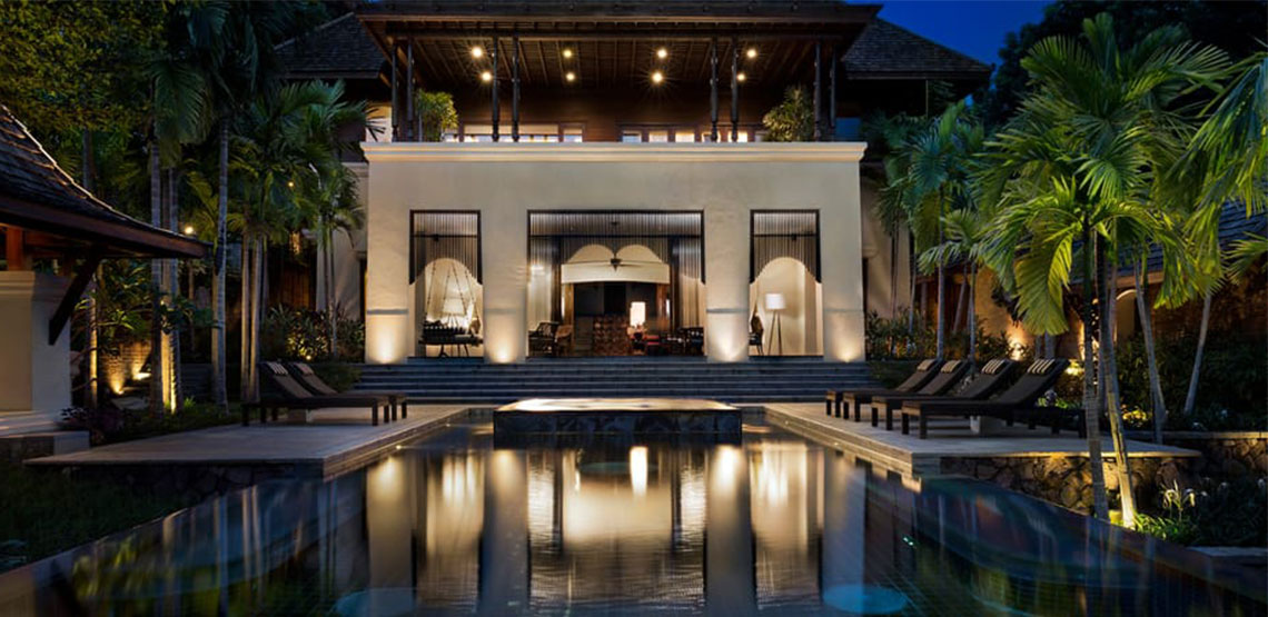 Opulent guest house with pool in foreground