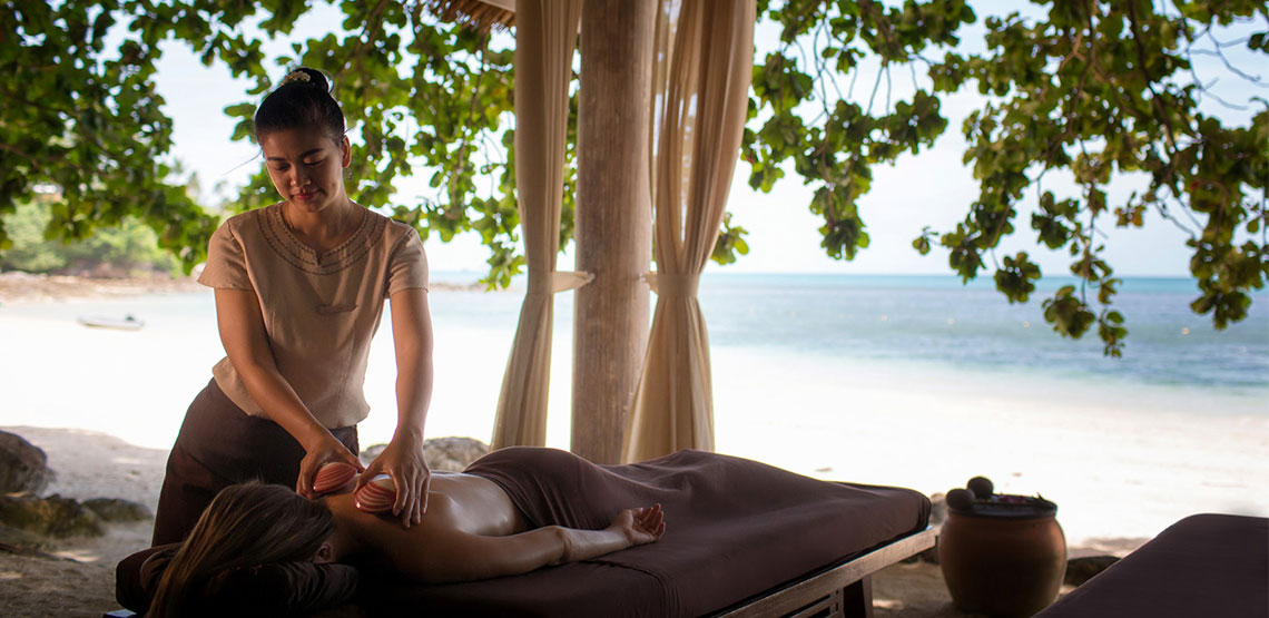 Someone receiving a massage on the beach