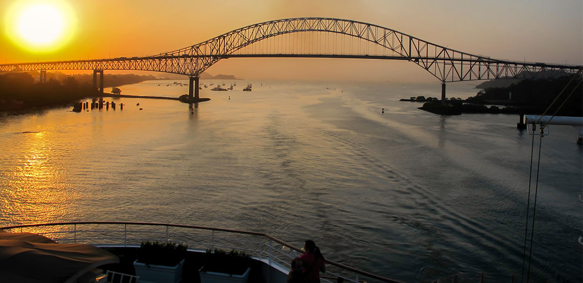 Bridge of the Americas over the Panama Canal at sunrise