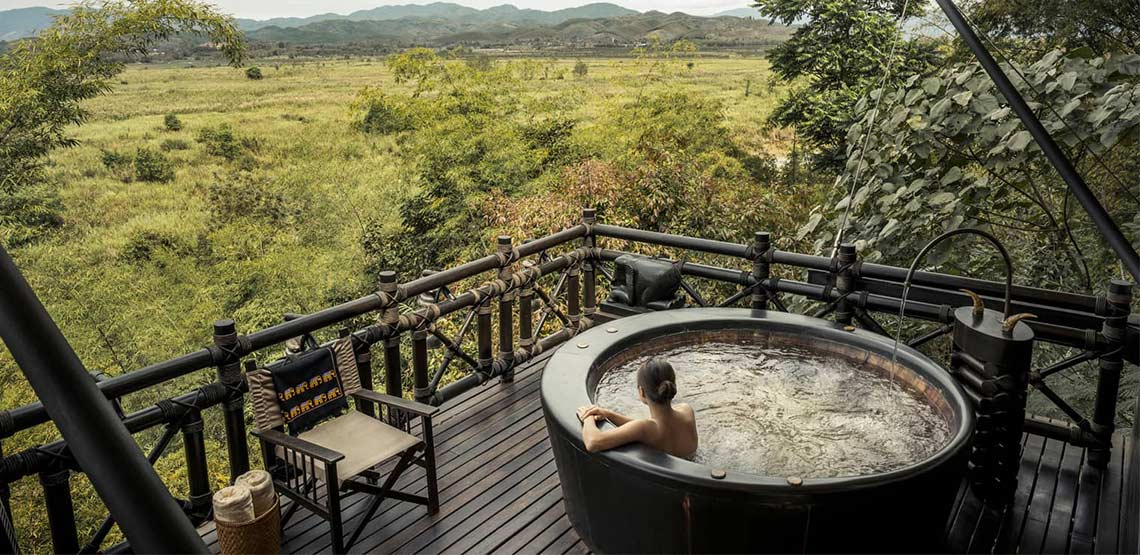 Hot tub on terrace overlooking field