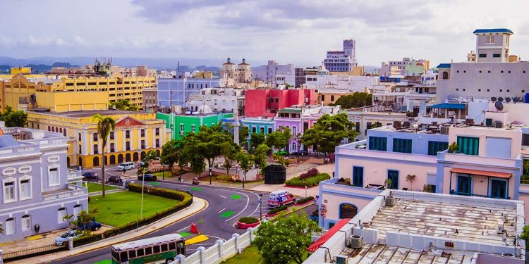 An aerial view of Old San Juan's buildings, their facades painted in a bright rainbow of colors