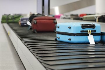 Suitcases on a conveyor belt.