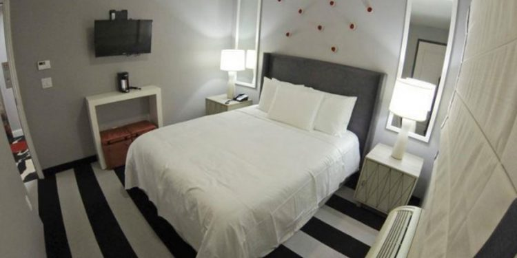White bed in small hotel room