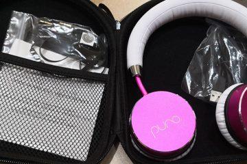 Pink headphones in an open case