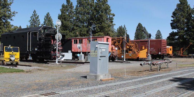 Trains sitting near tracks