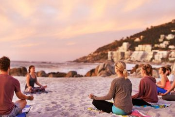 meditation class on a beach