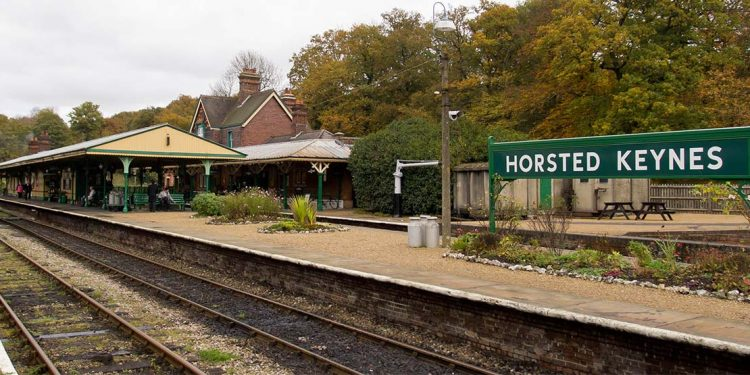 "Railway tracks in front of ""Horsted Keynes"" sign"