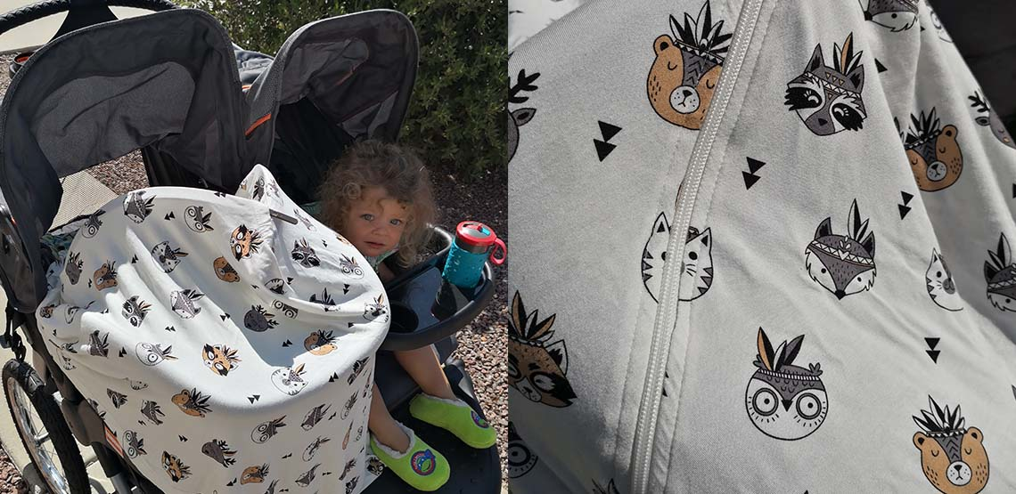 Animal print cover over a car seat in a double stroller
