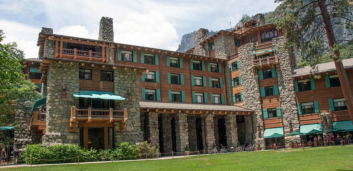 Hotel with green shutters and rock exterior