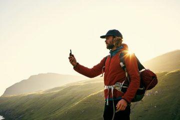 Man using smart phone while hiking