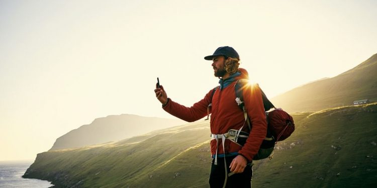 Man using smart phone while hiking