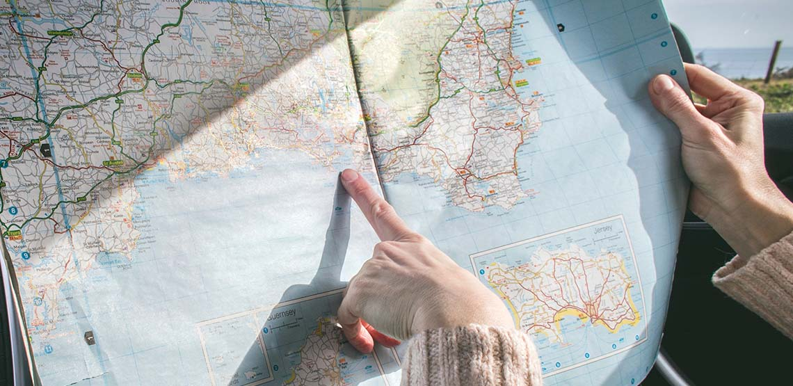 Someone pointing at a map.
