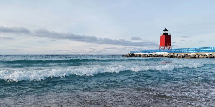 A beach and a red lighthouse.