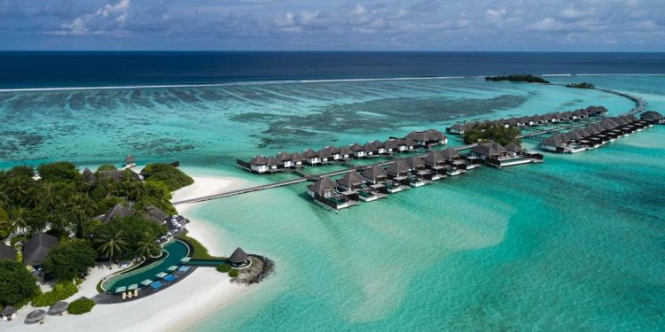 Blue water and beaches of Maldives.