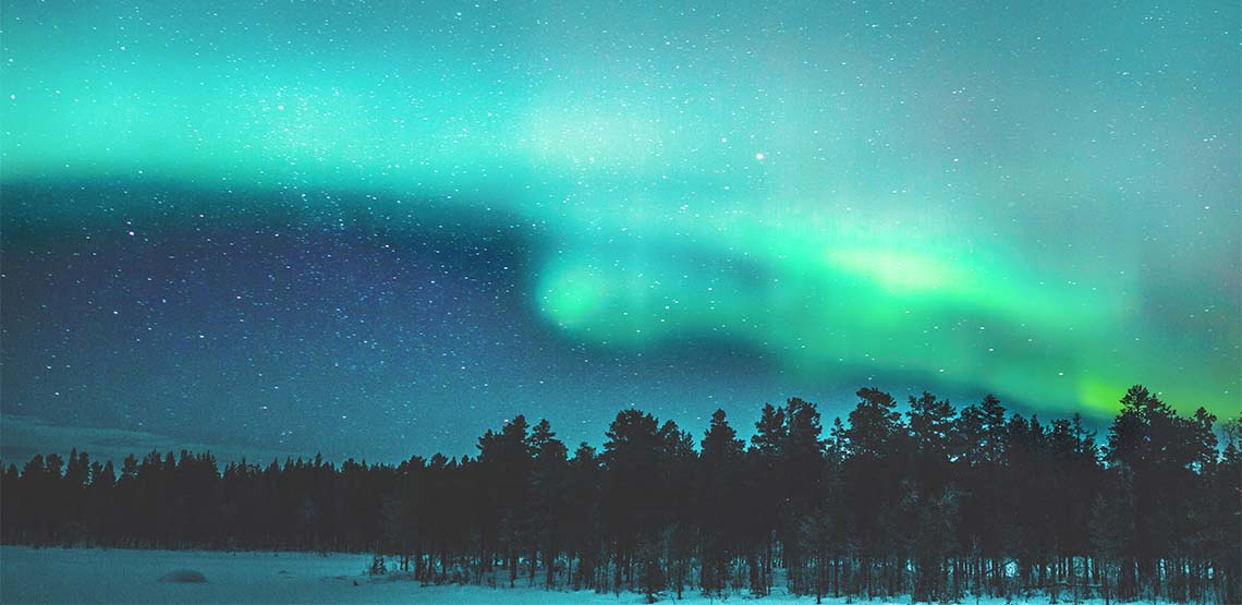 Landscape of green and blue Northern Lights.