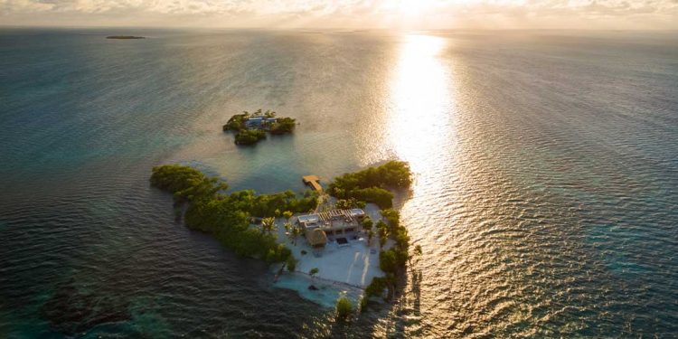 An overhead view of Gladden Island with the sunset in the background.