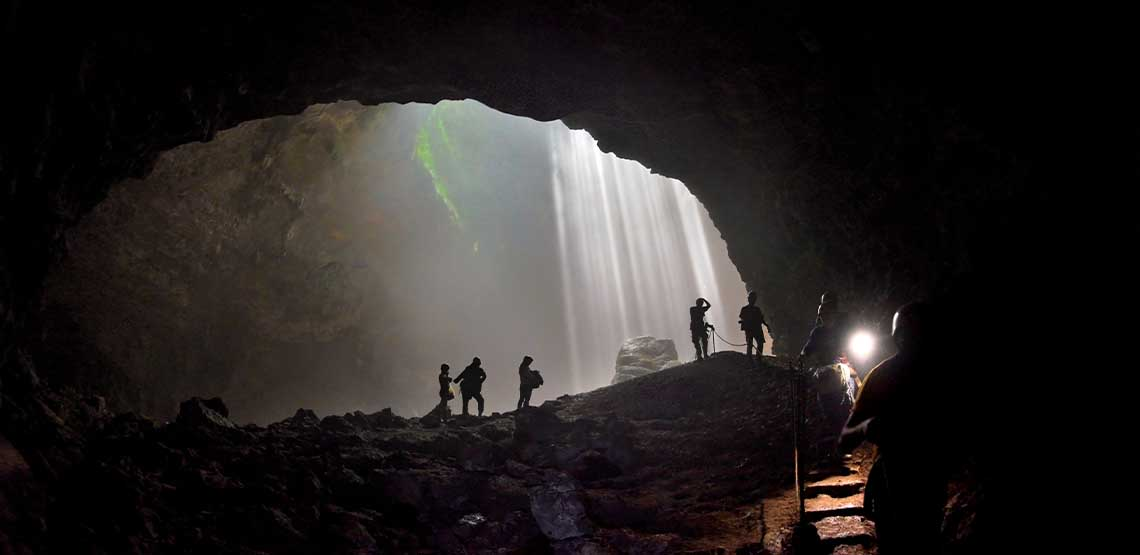 People in a dark cave.