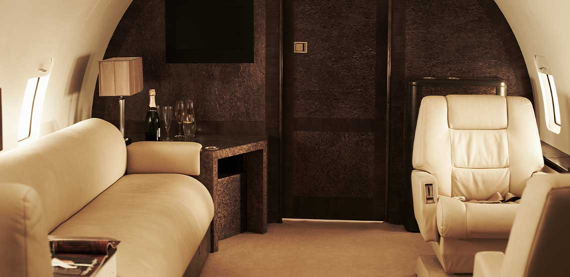 The interior of a private jet with leather seats.
