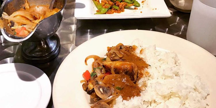 Rice and curry on a plate.