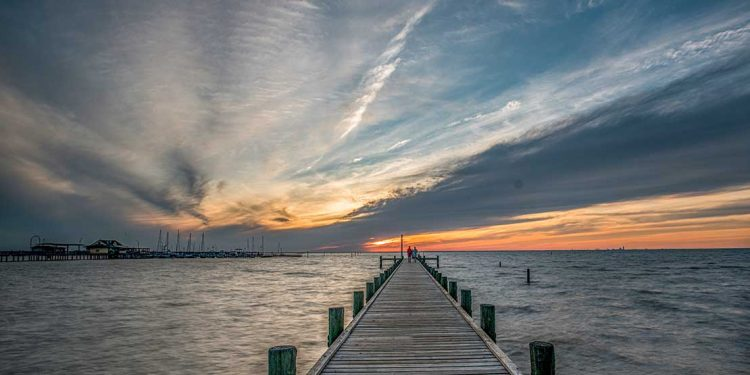A doc in Fairhope, Alabama at sunset.